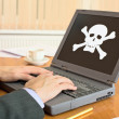 Laptop with pirate software — Foto de Stock   #2313163