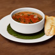 Seafood soup with toasted bread - Stock Photo