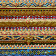 Thailand ornament on walls of buddhistic temple - Stock Photo