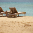 Two bamboo deck chairs in retro style — Stock Photo