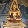 Gilded figure of Buddha in the temple. Indonesia — Stockfoto