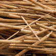 Debris - bamboo sticks in heap - Stock Photo