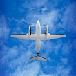 Bottom view - twin prop airplane on sky background — Stock Photo