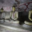 Row of Buddha statues in the ancient cave temple. Sri lanka, Dambulla — Stock Video