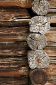 Ancient wooden wall - logs close up — Stock Photo