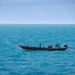 Old fishing boat goes by sea - fishermen working — Stock Photo