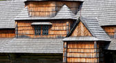 Fragments of facade of the old wooden architecture — Stock Photo