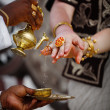Wedding in Sri Lanka - ritual watering fingers — Stock Photo
