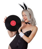 Playful blonde in a bunny suit with a vinyl record — Stock Photo