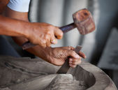 Hands woodcarver with the tools — Stock Photo