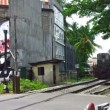 ALUTHGAMA, SRI LANKA - MAY 02: Passenger train passes railroad crossing on May 02, 2013 in Aluthgama, Sri Lanka. Sri Lanka Railways linking Colombo and many population centres and tourist destinations — Stock Video