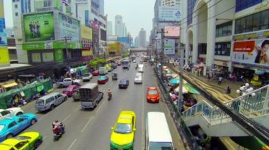 BANGKOK - APR 12: Cars and bus drive in a flow of megalopolis daily traffic on Apr 12, 2013 in Bangkok, Thailand. — Stock Video