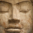 Face of stone Buddha statue — Stock Photo
