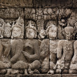 Buddhist carved relief at medieval Borobudur temple on Java, Ind — Stock Photo #27519759