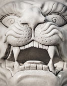 Stone lion head - marble statue — Stock Photo