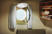 Porthole in the cabin of an old yacht — Stock Photo