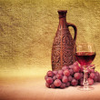 Artistic arrangement of bottles of wine and grap — Stock Photo #2947583