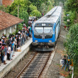 BENTOTA, SRI LANKA - APR 28: Train arrive to station with people — Stock Photo