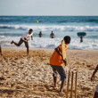 BENTOTA, SRI LANKA - APR 28: Teenagers play cricket with bat and — Stock Photo