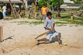 BENTOTA, SRI LANKA - APR 28: Children play cricket with bat and — Stok fotoğraf