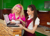 Two women with a laptop looking for a recipe in the Internet — Stock Photo