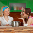 Two girlfriends on the kitchen — Stock Photo