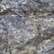 Granite rock with stains and cracks - a natural background — Stock Photo