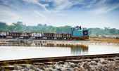 Old small locomotive and freight train — Stock Photo
