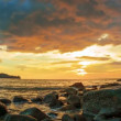 Stock Video: Video 1920x1080 - Beautiful sunset over the tropical ocean coast with rocks