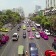 BANGKOK - APR 12: Cars and taxis drive in a flow of megapolis traffic on Apr 12, 2013 in Bangkok, Thailand. There are more than 70 thousand licensed taxi cars in the city. — Stock Video