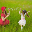 Mum and daughter starting up soap bubbles — Stock Photo #3600640