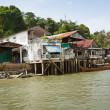 Stock Photo: Old houses on river bank. Thailand