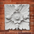 Stock Photo: Stone lotus flower decoration on wall of temple on Bali