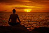 Man meditating at sunset. Tropical beach of Thailand — Stock Photo