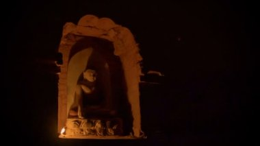 High definition video - Dark gloomy room in a Buddhist temple lit one candle — Stock Video