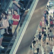 SINGAPORE - DEC 31 2013: A crowd on the escalator in the shopping area of Marina Bay Sands. New Year shopping — Stock Video