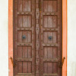 Old wooden door on a building facade. India, Agra — Stock Photo #43914967