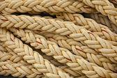 Nautical knots. Big marine vintage sea ropes in heap background — Foto de Stock