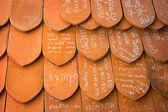 AYUTHAYA, THAILAND - 22 NOV 2013: Names written in chalk on clay — Zdjęcie stockowe