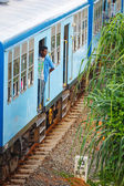 BENTOTA, SRI LANKA - 28 APR 2013: man stay in a door of a blue t — Stok fotoğraf