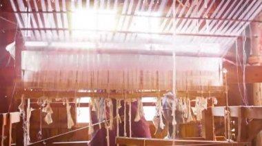 INLE LAKE, MYANMAR - CIRCA JAN 2014: Old loom. Unusual perspective from below — Stock Video