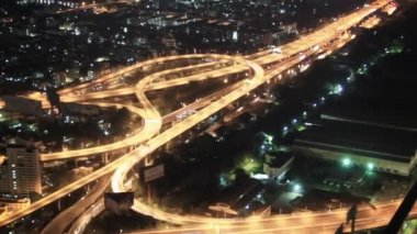 Video 1080p - Top view on the night city and highways. Bangkok, Thailand — Stock Video