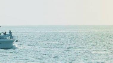 PHUKET, THAILAND - 05 OCT 2013: White motor yacht navigate in calm clean sea — Stock Video