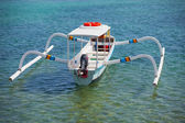 Balinese traditional boat with motor - double outrigger jukung — Stock Photo