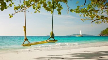 Video 1080p - Swing on a background of the tropical sea with yachts — Vidéo