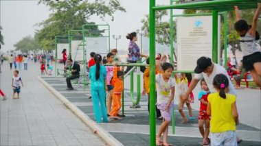 PHNOM PENH, CAMBODIA - 29 DEC 2013: Children and adults involved in sports right on the city street — Stock Video