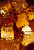 View of the ice cubes in cola background — Stock Photo