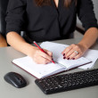 Businesswoman writing — Foto de Stock
