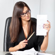 Portrait of a beautiful executive woman secretary at work while — Stock Photo #36524893