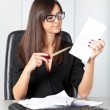 Portrait of a beautiful executive woman secretary at work while — Stock Photo #36524929